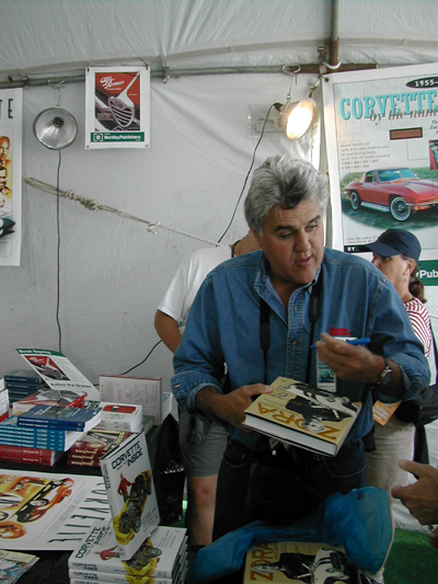 Just another autograph seeker?  Jay Leno brings his copy of Zora Arkus-Duntov: The Legend Behind Corvette to the Bentley Publishers booth at the Monterey Historic Races to get it signed by author Jerry Burton!